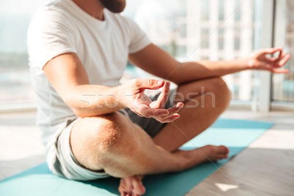 Kép szakállas férfi meditáció ablak otthon Stock fotó © deandrobot