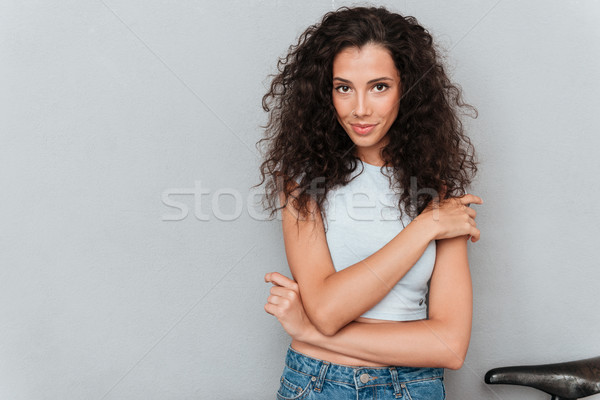 Carefree calm lady looking seriously camera Stock photo © deandrobot