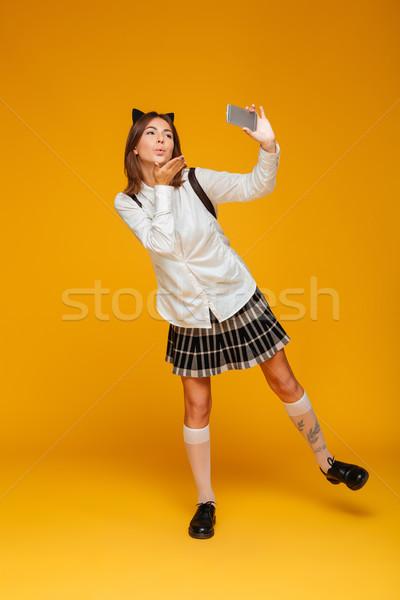 Retrato cute colegiala uniforme Foto stock © deandrobot