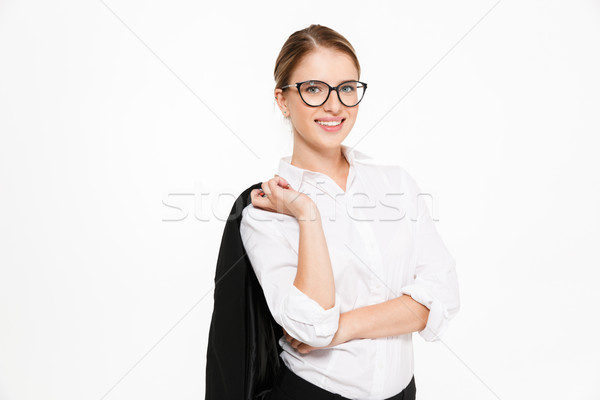 0ab2d9c5f72 Smiling blonde business woman in eyeglasses holding her jacket Stock photo  © deandrobot