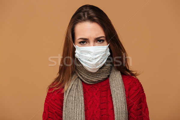 Young sick brunette woman in protective mask feeling bad over be Stock photo © deandrobot