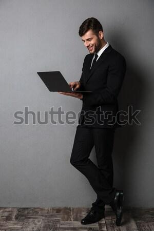 Tam uzunlukta fotoğraf genç başarılı işadamı siyah takım elbise Stok fotoğraf © deandrobot
