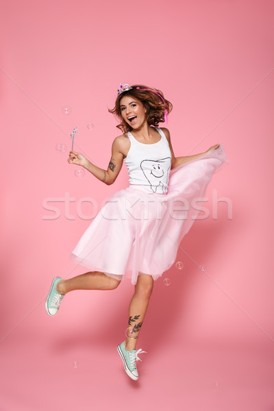 Full length portrait of charming princess with magic wand jumpin Stock photo © deandrobot