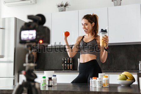 Satisfied healthy young girl recording her video blog Stock photo © deandrobot
