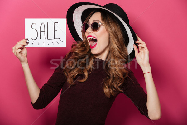 Portrait of a joyful pretty girl wearing hat Stock photo © deandrobot