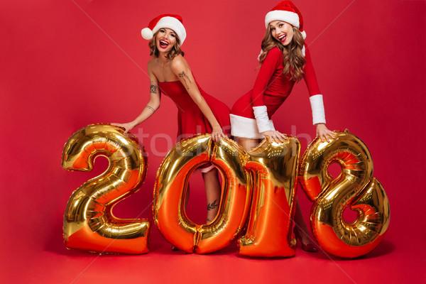 Full length portrait of two pretty happy girls Stock photo © deandrobot