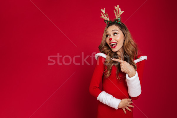 Portrait of a smiling pretty girl Stock photo © deandrobot