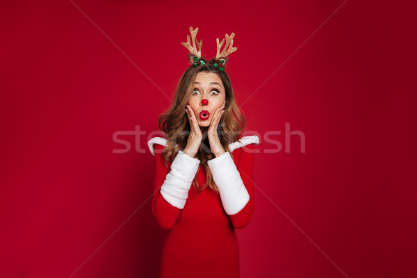 Portrait of a surprised pretty girl Stock photo © deandrobot