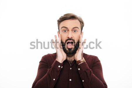 Close up portrait of a surprised young bearded man Stock photo © deandrobot