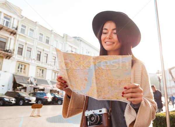 Portrait of a happy pretty woman tourist Stock photo © deandrobot