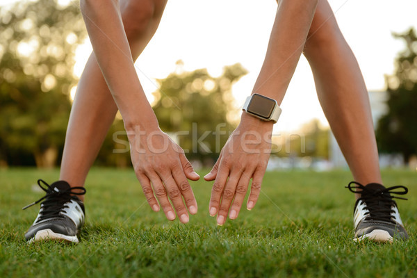 Close up of a female arms and legs doing stretching Stock photo © deandrobot
