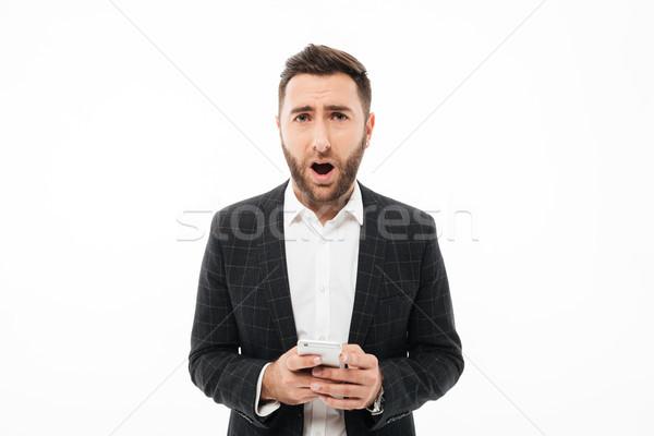 Сток-фото: портрет · путать · человека · мобильного · телефона · изолированный