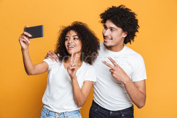 Portré mosolyog fiatal afro amerikai pár Stock fotó © deandrobot