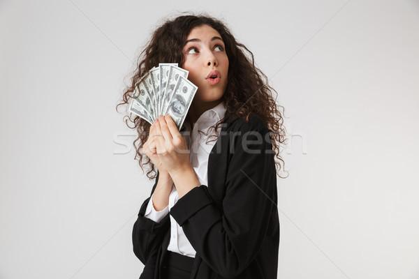 Scioccato giovani donna d'affari soldi foto isolato Foto d'archivio © deandrobot