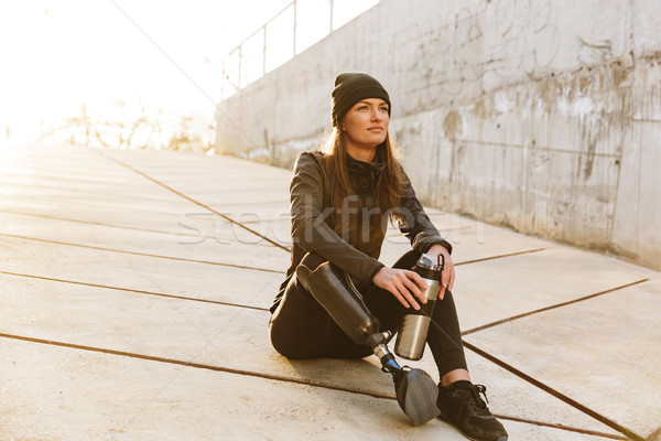 Photo of athletic disabled girl with prosthetic leg in sportswea Stock photo © deandrobot