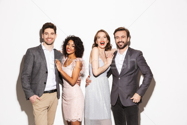 Group of well dressed multiracial people standing together Stock photo © deandrobot