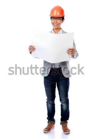 Asian jonge man veiligheidshelm naar blauwdruk Stockfoto © deandrobot