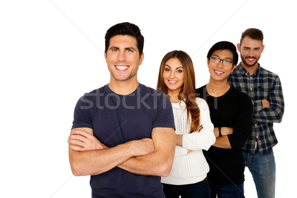 Smiling young friends standing in a row over white background Stock photo © deandrobot