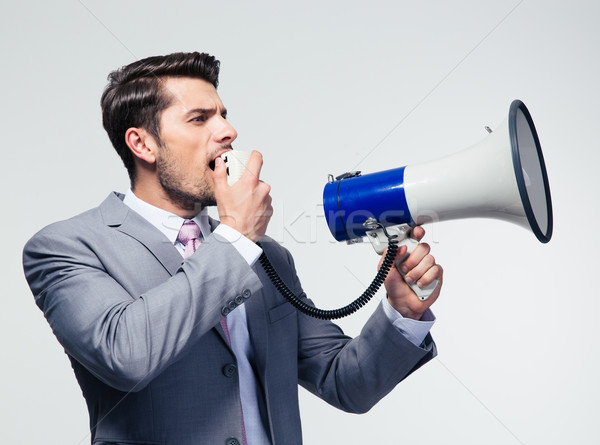Businessman shouting in megaphone Stock photo © deandrobot