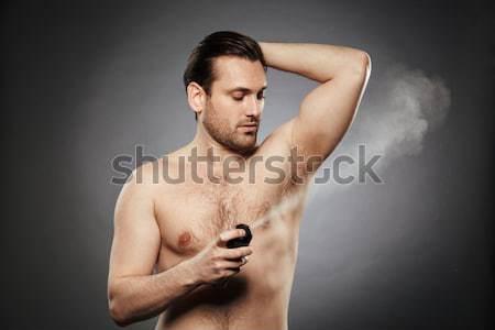 Izmos férfi elektromos borotva fiatalember szürke Stock fotó © deandrobot