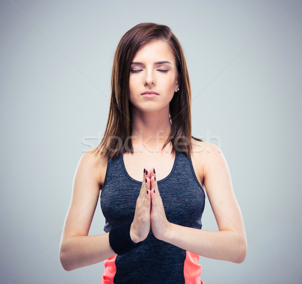 Fitness pretty woman in meditation  Stock photo © deandrobot