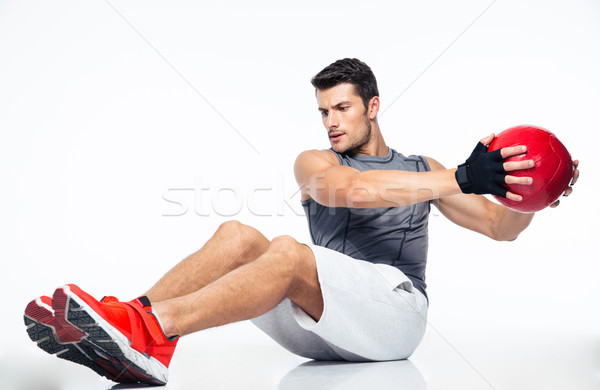 Fitness man working out with fitness ball Stock photo © deandrobot