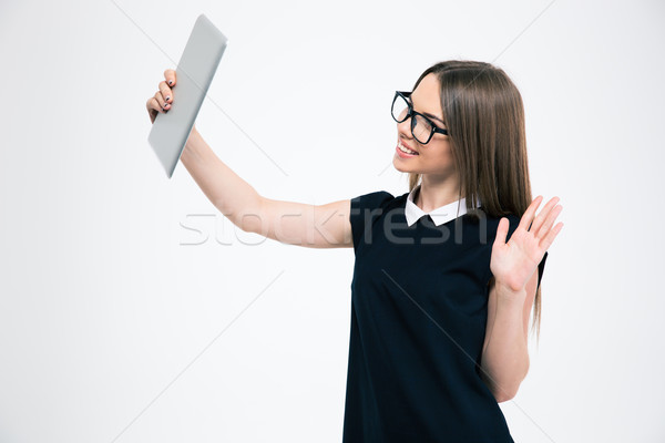 Smiling woman making video chat on tablet computer  Stock photo © deandrobot