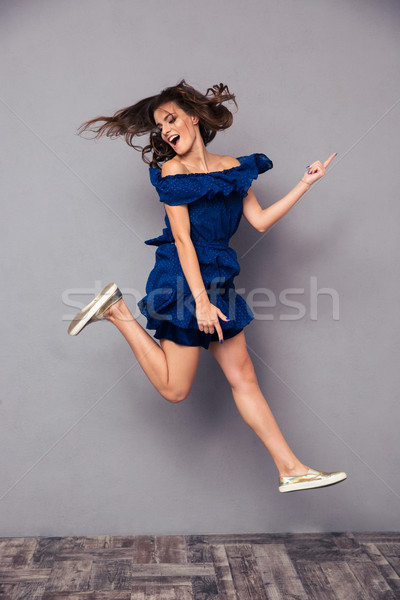 Portrait of a funny cheerful woman Stock photo © deandrobot