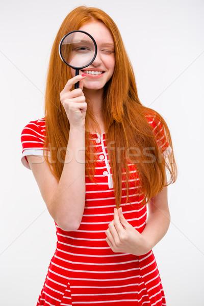 Szórakoztató örömteli lány néz nagyító üveg Stock fotó © deandrobot