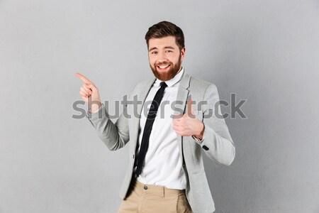 Happy businessman showing ok sign Stock photo © deandrobot