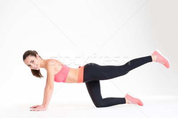 Szczęśliwy dość młodych sportsmenka fitness dres Zdjęcia stock © deandrobot