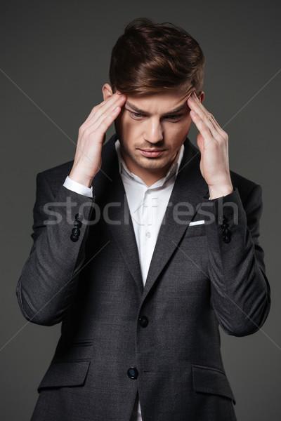 расстраивать несчастный бизнесмен прикасаться головная боль молодые Сток-фото © deandrobot