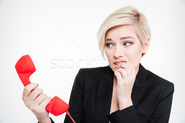 Frightened businesswoman holding retro phone tube Stock photo © deandrobot
