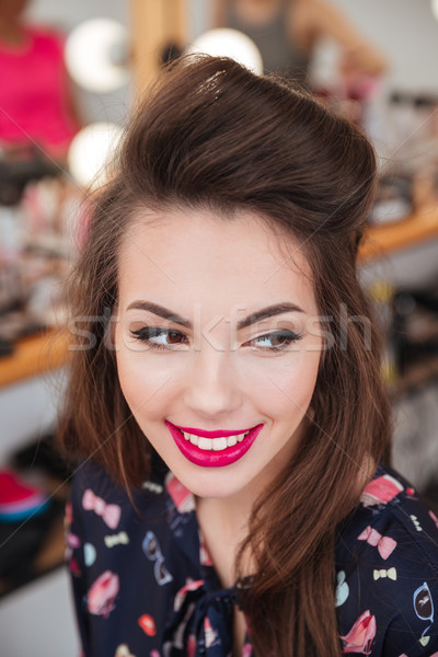 Beautiful happy woman with makeup and hairstyle in beauty salon Stock photo © deandrobot