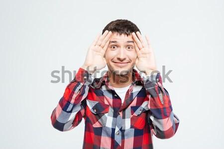 Peinzend man permanente geïsoleerd witte hand Stockfoto © deandrobot