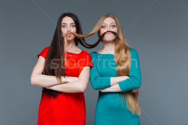 Iki komik kızlar bıyık saç Stok fotoğraf © deandrobot