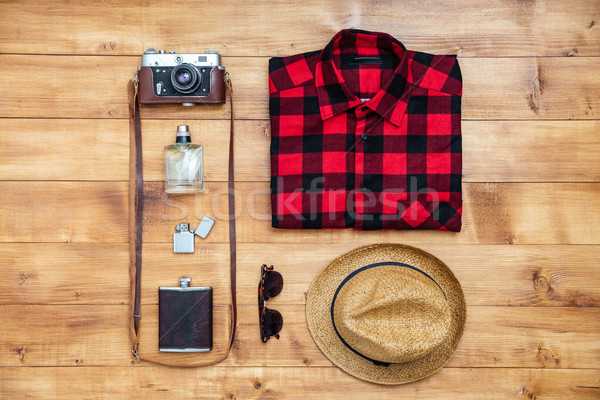 Travel concept shirt, camera, hat, flask, lighter,eyeglasses, pe Stock photo © deandrobot