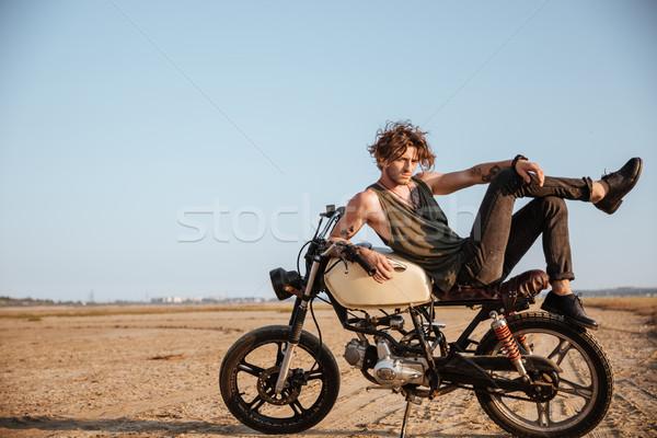 Fiatal brutális férfi fektet motorkerékpár pózol Stock fotó © deandrobot