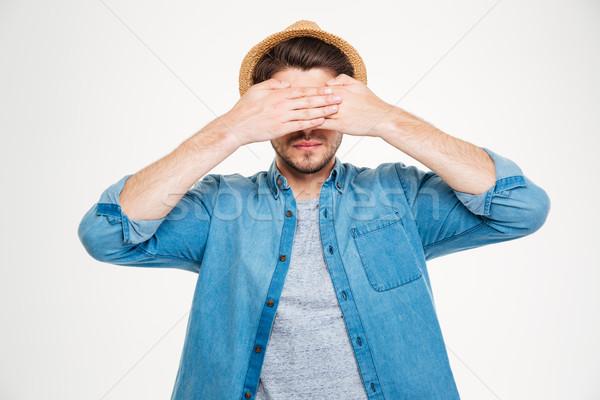 Foto stock: Sério · moço · coberto · olhos · mãos · azul