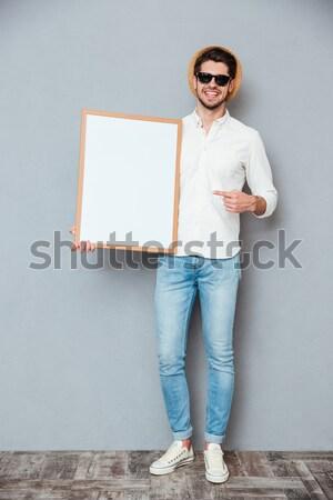 幸せ 男 サングラス 立って ホワイトボード ストックフォト © deandrobot