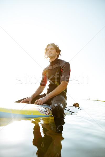 красивый молодые Surfer человека сидят Сток-фото © deandrobot