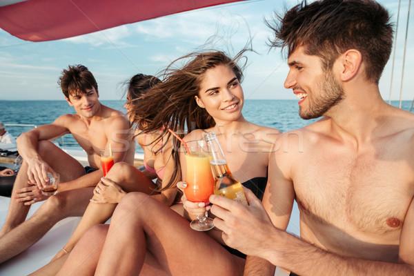 Grupy znajomych pitnej strony żeglarstwo łodzi Zdjęcia stock © deandrobot