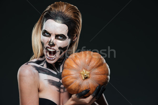 Woman with scared gothic makeup holding pumpkin and shouting Stock photo © deandrobot