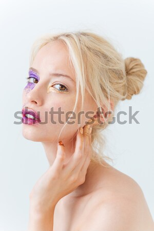 Beauty portrait of girl with creative makeup touching her chin Stock photo © deandrobot