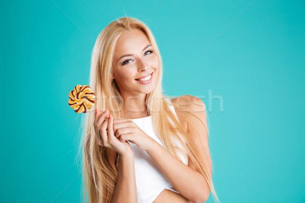 Mujer pelo largo pirulí mirando cámara Foto stock © deandrobot