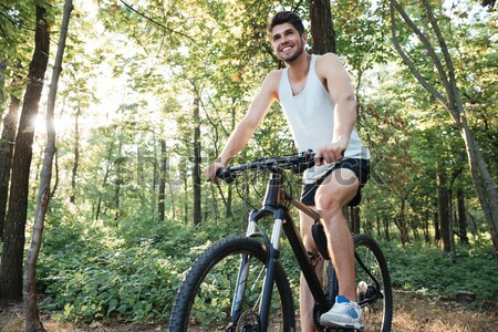 Young cyclist in forest Stock photo © deandrobot