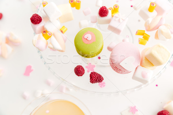 Stock photo: Closeup of french macaroons, marshmallows and berries on the plate