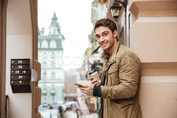 человека ходьбе улице питьевой Сток-фото © deandrobot