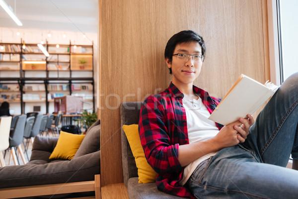 Stock fotó: ázsiai · diák · olvas · könyv · egyetem · könyvtár