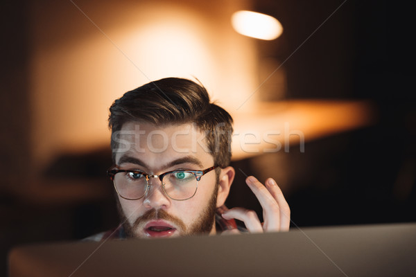 Bearded young shocked web designer working late at night Stock photo © deandrobot